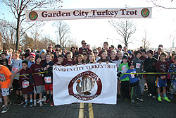 young runners at the start line of the fun run with more than 1900 other runners behind them photo courtesy of jack mccoy photography - Garden City Turkey Trot