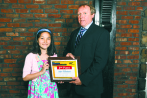 AAA Director of Traffic Safety John Corlett presents a second place award to Stewart School fifth grader Dian Wakeham  (Photo by Marquee Photography)