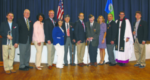From left: Brian Ingegno (Garden City High School), NYS Senator Kemp Hannon; Hempstead Town Clerk Nasrin Ahmad; Hempstead Receiver of Taxes Donald Clavin; American Legion Ladies Auxiliary President Joan Nedelka; American Legion Commander Joseph Frey; New York State Assemblyman Ed Ra; World War II veteran and Grand Marshal Edward T. Brown; Nassau County Legislator Laura Schaefer; Garden City Mayor Nicholas Episcopia; Dean Michael Sniffen and Tom Crafa (Garden City High School)