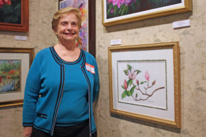 "Harriet Carotenuto and her painting, ""Magnolias in Bloom."" (Photos by Suzie and Robert Alvey)"