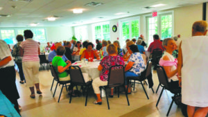 "Garden City Seniors enjoying the Chamber's ""Chow Down"" with food provided by Garden City Pizza."