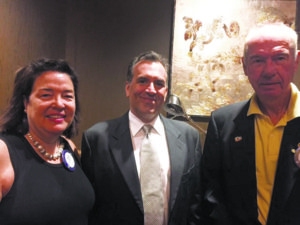Club President Susan MacDonald, new member Peter Arianas and inductor Thomas Gelsdorf