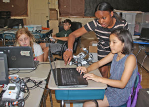 """Students working to design their sound sensors in """"Robotics."""""""