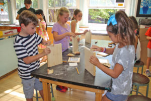 """Students are making frames for their art projects in """"Woodworking."""""""