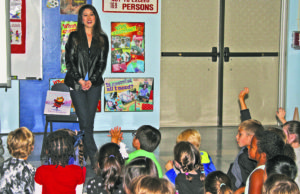 After reading her new book Cara's Kindness at Hemlock, Kristi Yamaguchi answered questions posed by kindergartners and first graders.