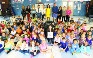 At Homestead,  Kristi Yamaguchi posed with the first graders  and their teachers after her reading of Cara's Kindness.