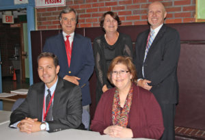 Pictured are (seated) Board of Education Vice President Tom Pinou and President Angela Heineman; (standing, left to right) Trustees Robert Martin, Laura Hastings, and William Holub.